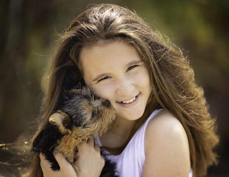 Cute young girl with yorkie puppy. royalty free stock images