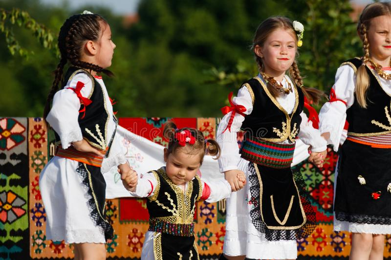 Young girls in traditional costumes of Vojvodina, Sebia on a parade royalty free stock images
