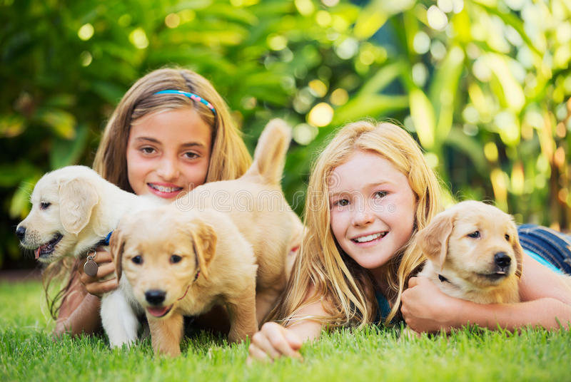 Cute Young Girls with Puppies stock photos