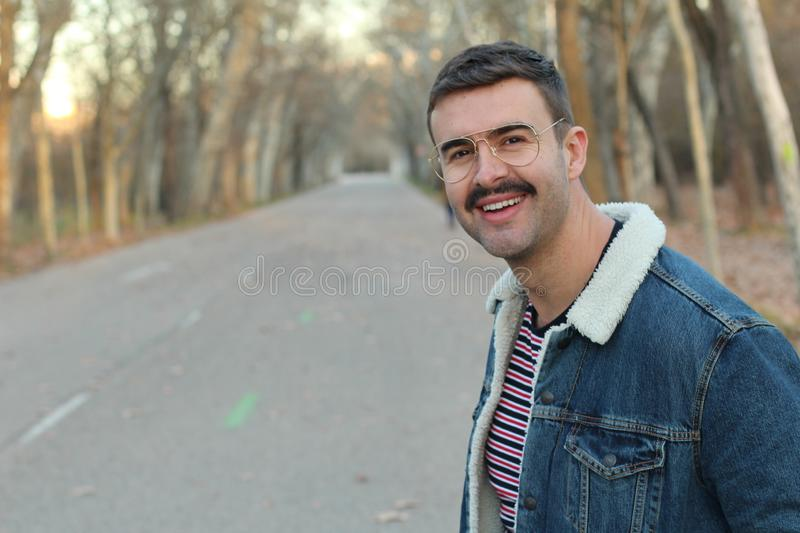 Cute young man with a moustache royalty free stock photography