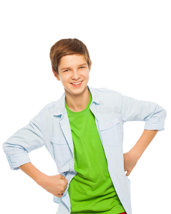 Cute young teen boy smiling with hands on waist stock photos