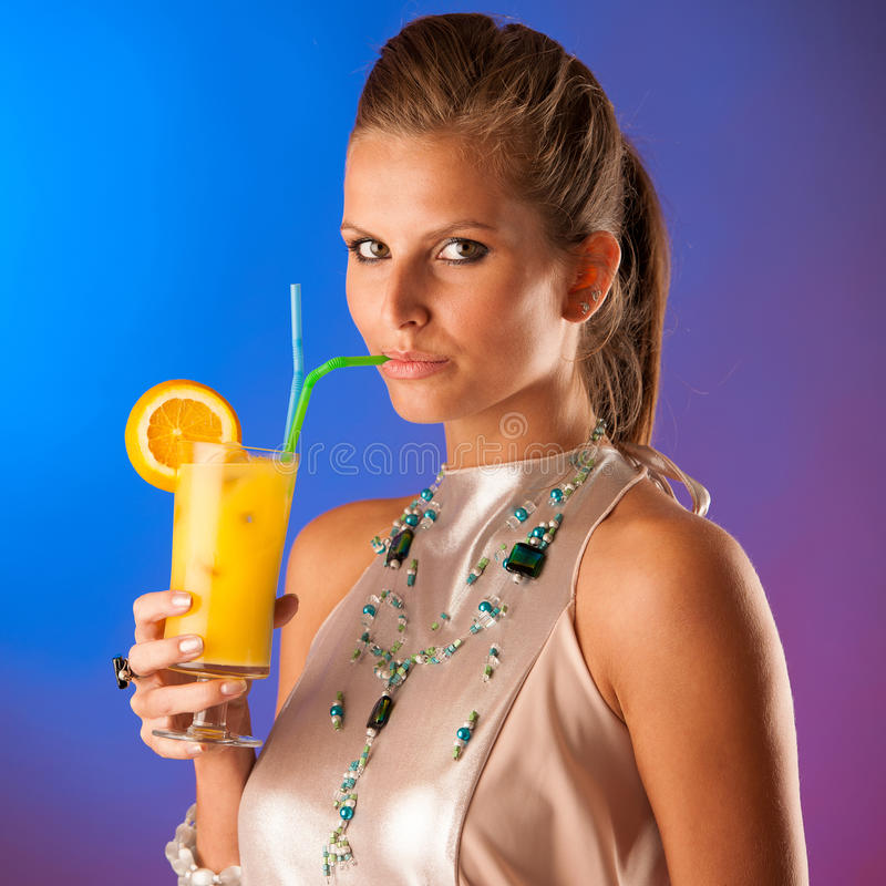 Cute young woman with cocktail royalty free stock photos