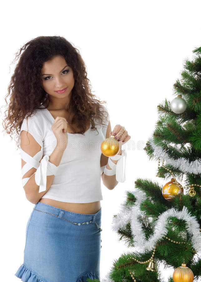 Download Cute Young Woman Decorate Christmas Tree Stock Photo - Image: 10764084