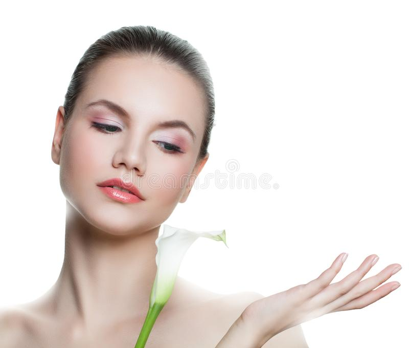 Cute young woman with empty copy space on the open hand isolated on white. Skincare and wellness concept. Presenting your product.  stock photography