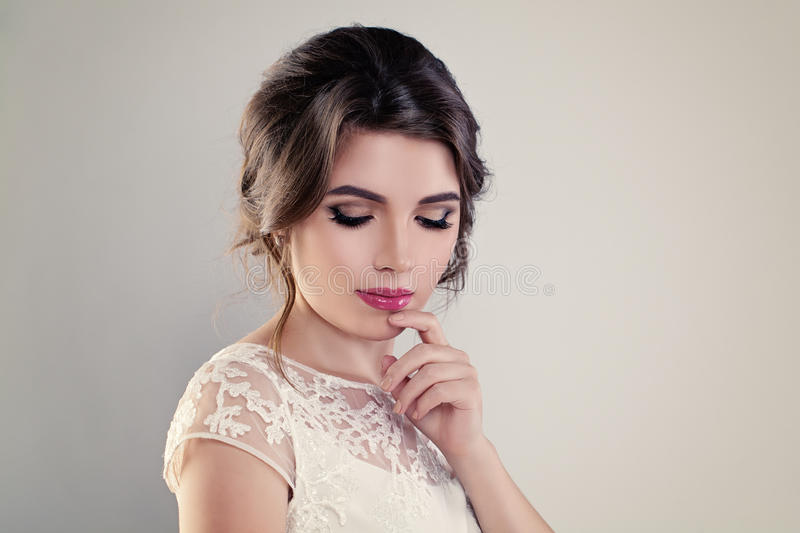 Cute Young Woman Fiancee with Perfect Bridal Hairstyle royalty free stock photo