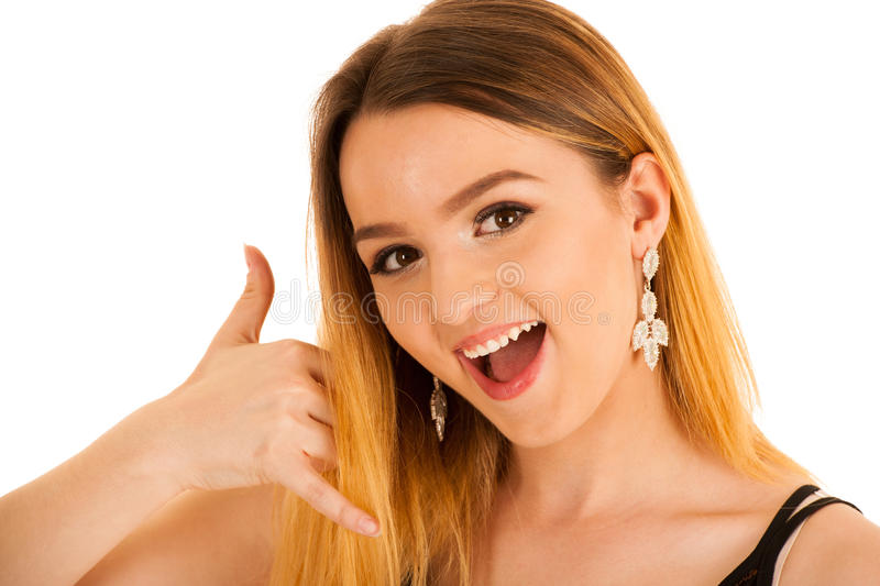 Cute young woman gesturing call me isolated over white background royalty free stock images