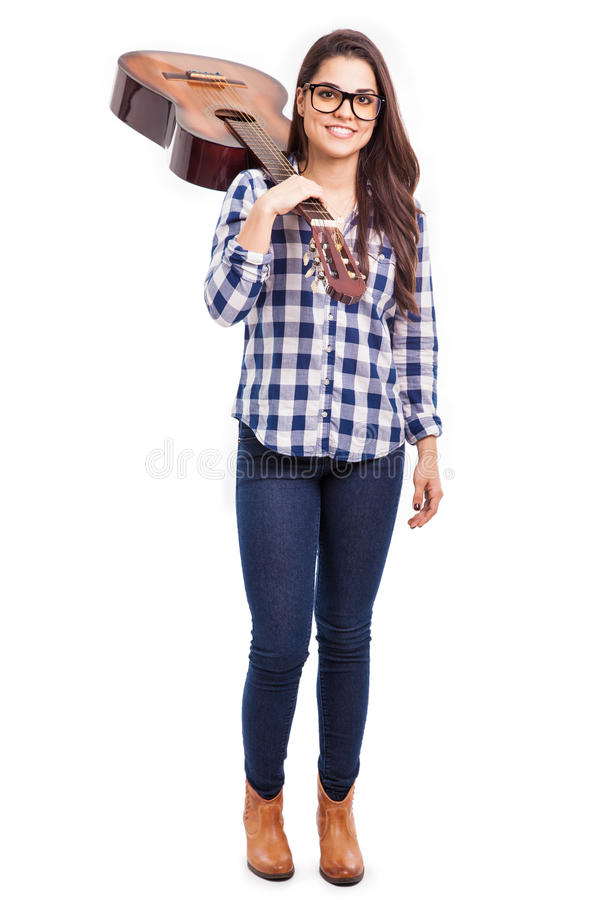 Cute young woman with a guitar stock photo