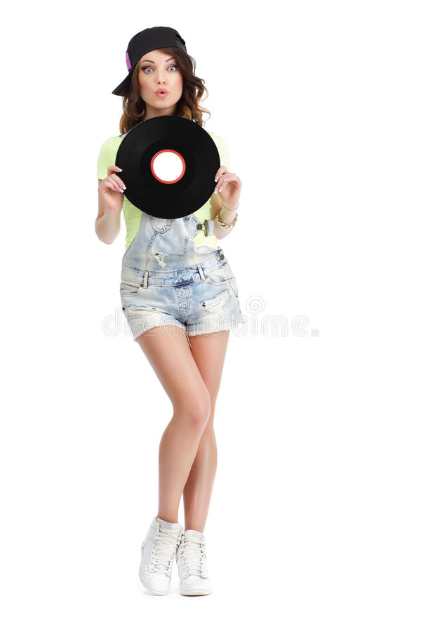 Cute Young Woman in Jeans Shorts holding Vinyl Record stock photos