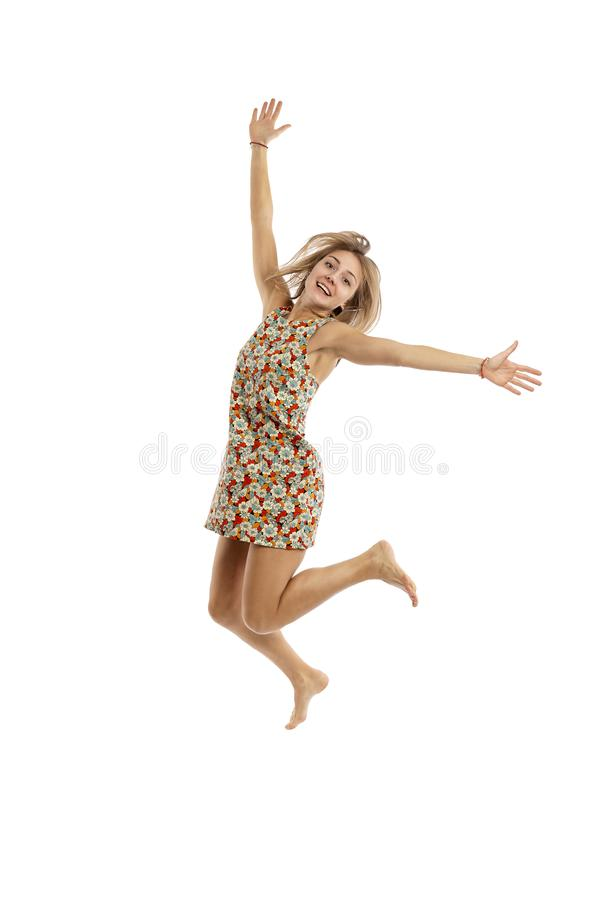 Cute young woman in a jump stock photography