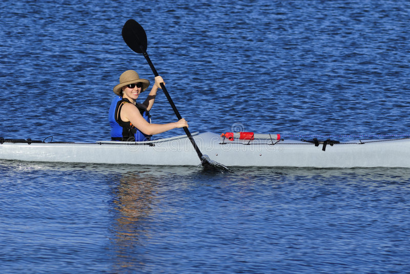 Cute young woman kayaking in California royalty free stock photo