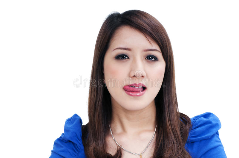 Cute young woman licking lips stock photo