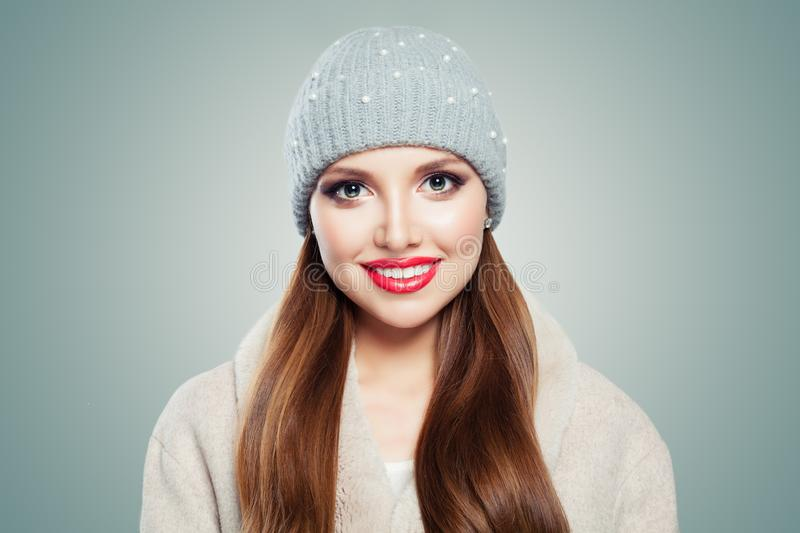 Cute young woman portrait. Pretty model girl in hat on gray background royalty free stock photography