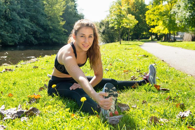 Cute young woman sporty girl workout outdoor royalty free stock photography