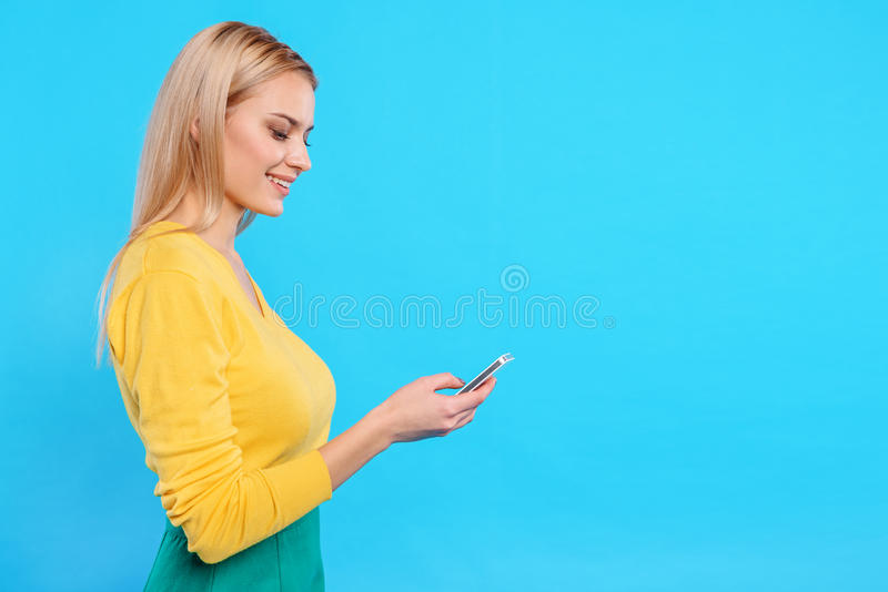 Cute young woman using mobile phone stock photo