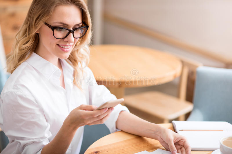 Cute young woman using phone stock photo