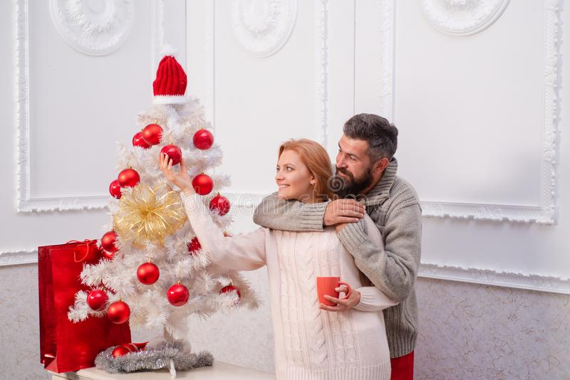 Cute young woman and handsome man celebrate Happy new year. Happy couple over christmas tree lights background. Cute young women and handsome men celebrate royalty free stock photos