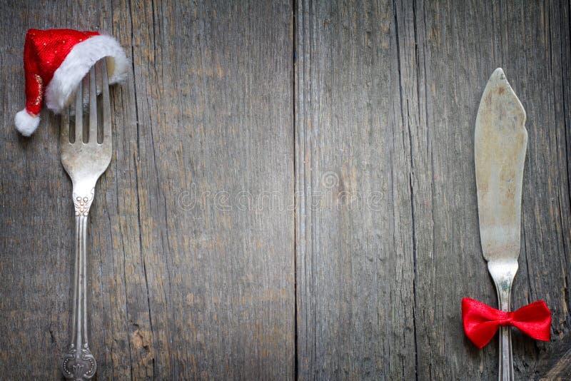 Cutelaria do Natal no fundo retro do menu do alimento do sumário da tabela imagem de stock royalty free