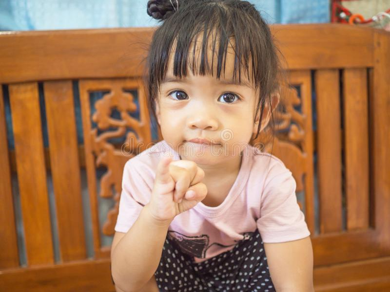 The cuteness, the freshness of the little girl, and the poses for taking pictures.  stock photos