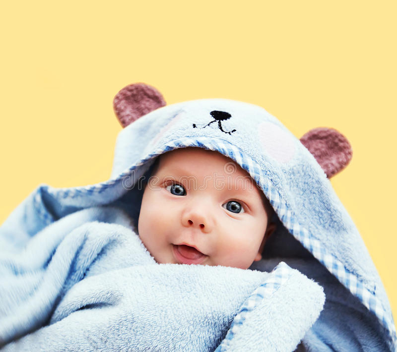 Cutest baby child after bath. With towel on head. Adorable smiling baby boy stock photo