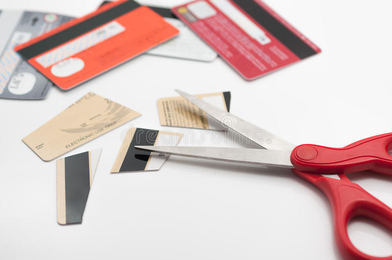 Cuting credit cards. Cuting credit cards with scissors royalty free stock image