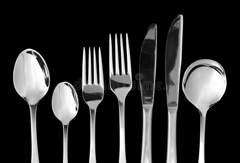 Cutlery. Silver cutlery, on black background. Knives, forks and spoons