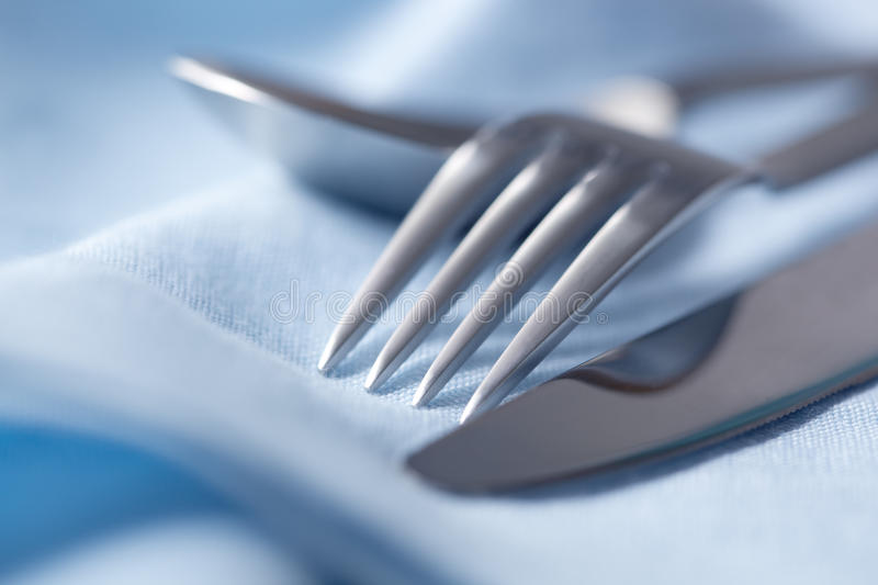 Download Cutlery on Blue Linen stock photo. Image of tableware - 11379272