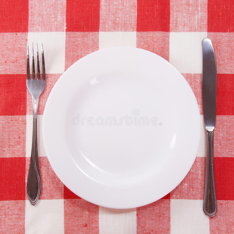 Download Cutlery On Checkered Tablecloth Stock Photo - Image: 16080482