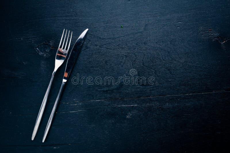 cutlery Em um fundo de madeira fotos de stock