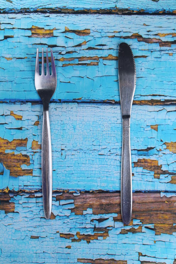 Cutlery - fork,knife. These are cutlery on blue wooden backdrop stock photography