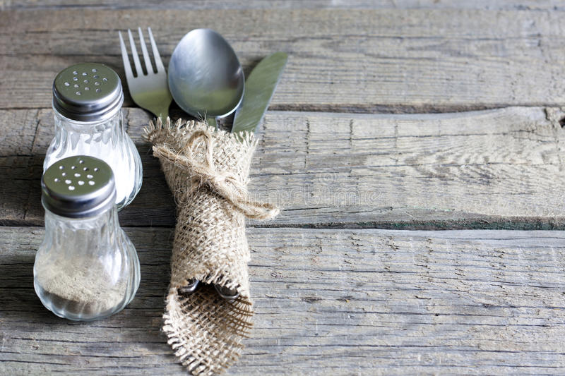 Cutlery kitchenware on old wooden boards background stock photos