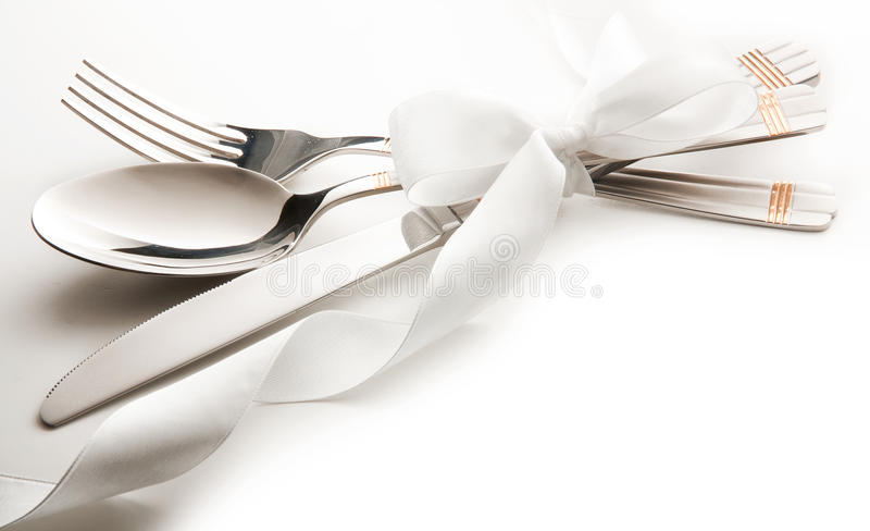 Cutlery. Knife, spoon and fork tied ribbon. isolated on a white background royalty free stock photos
