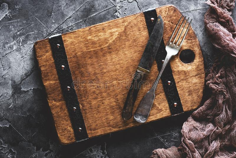Cutlery and old cutting board. Food menu concept royalty free stock photos