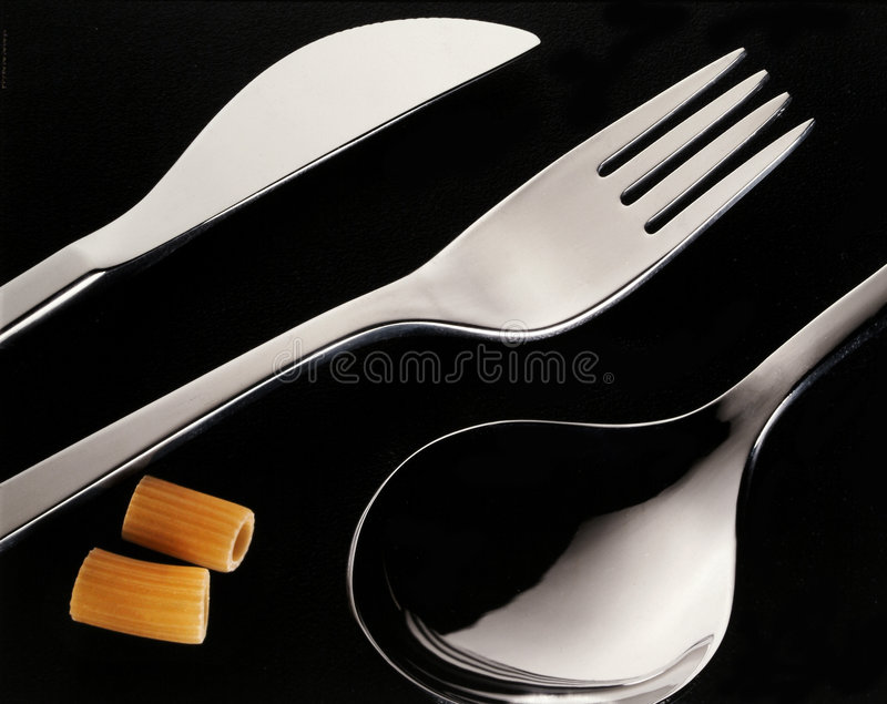 Cutlery with pasta royalty free stock photography
