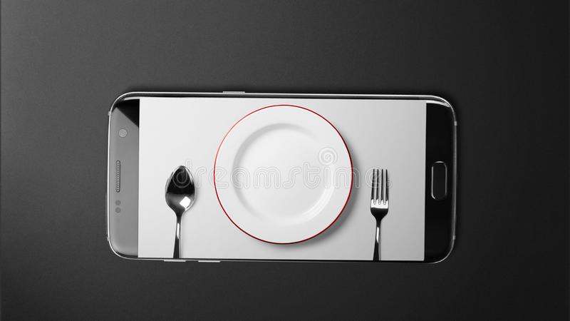 Cutlery screen on black smartphone on black background. | stock photos
