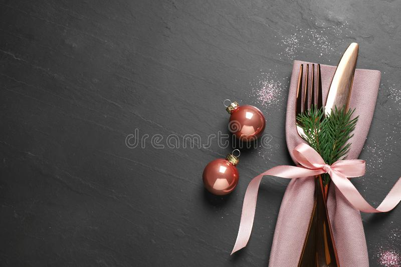 Cutlery set on black table, top view. Christmas celebration royalty free stock photos