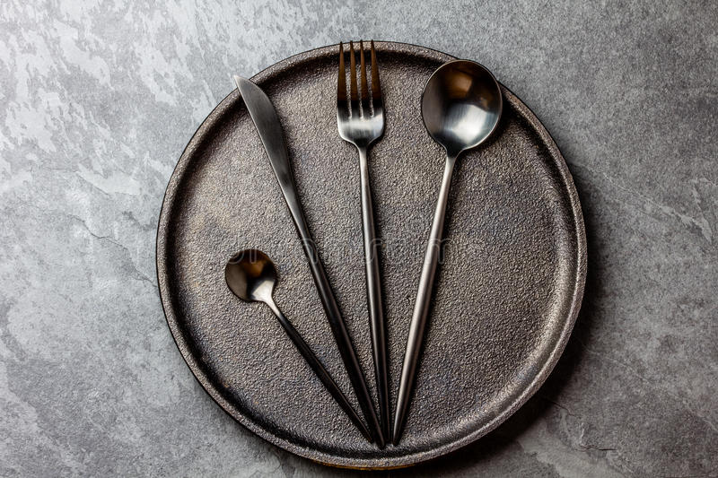 Download Cutlery Set On Plate. Black Table Setting. Top View Stock Image - Image & Cutlery Set On Plate. Black Table Setting. Top View Stock Image ...