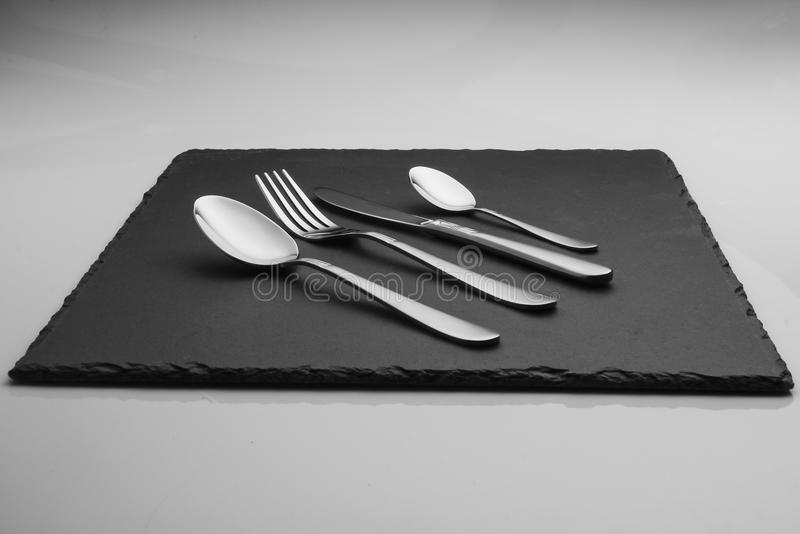 cutlery set on slate tile stock images
