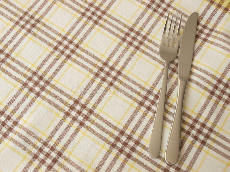 Cutlery and table cloth stock photos