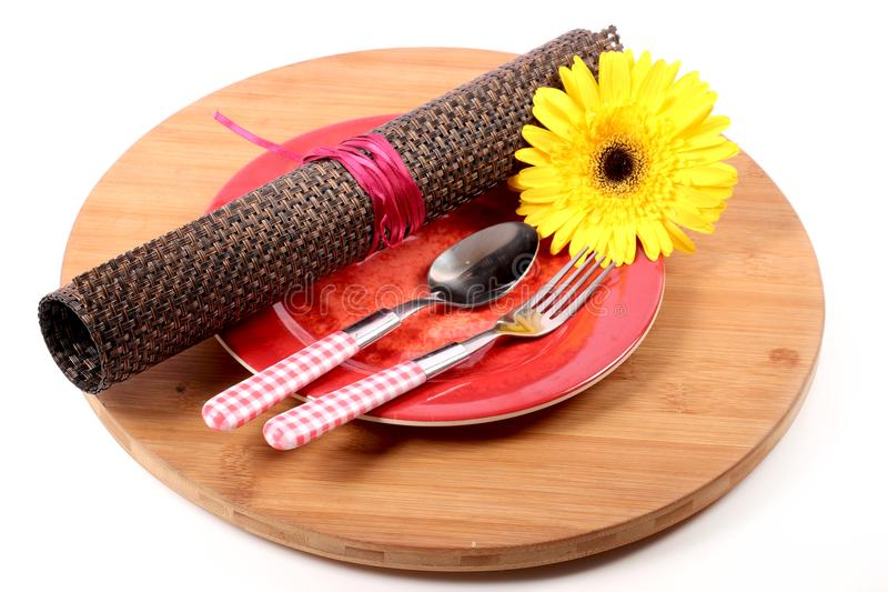 Cutlery and table mat stock images