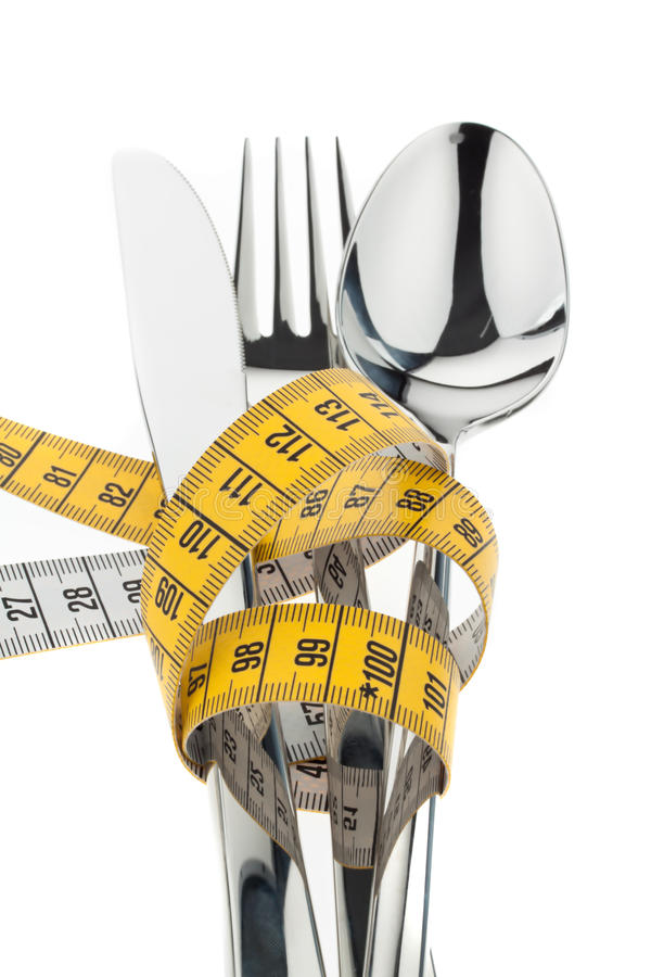 Cutlery with tape. royalty free stock photos