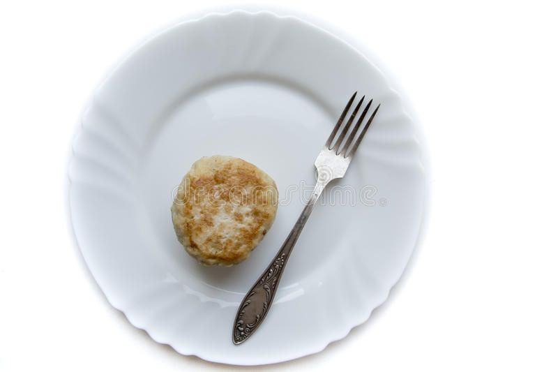 Cutlet diet. Dietary chop on bright plate on white background royalty free stock photography