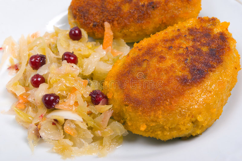 Cutlets in a plate with vegetables stock image