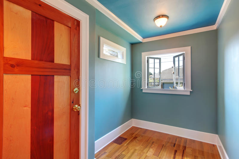Cutom wood door in blue empty room royalty free stock photography