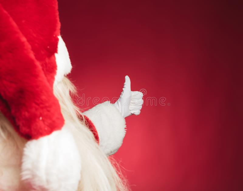 Cutout back view of santa claus making ok sign stock photography