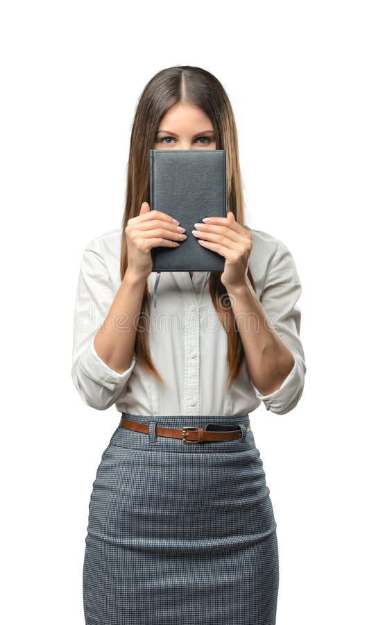 Cutout business woman holding a book and covering her face. royalty free stock photos