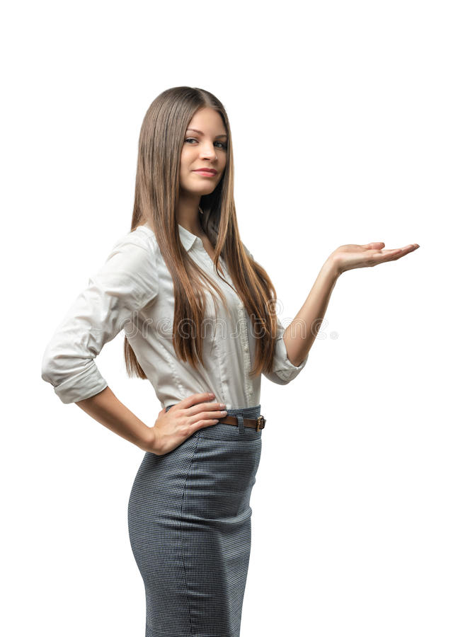 Cutout female model standing sideways raised her hand to present something royalty free stock photos
