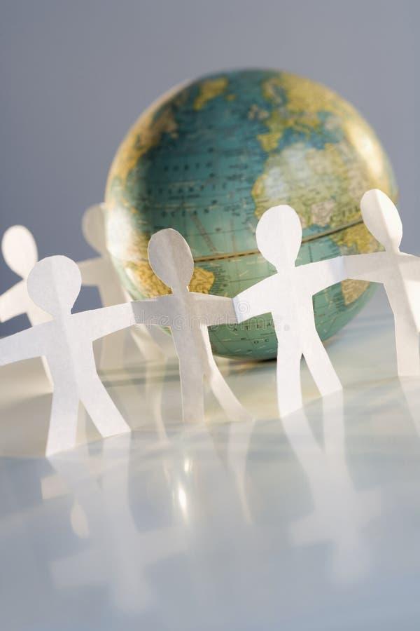 Cutout people and globe