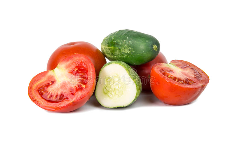 Cutted cucumber and tomatoes stock images
