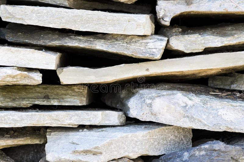 Cutted decorative rocks in a background composition stock photo
