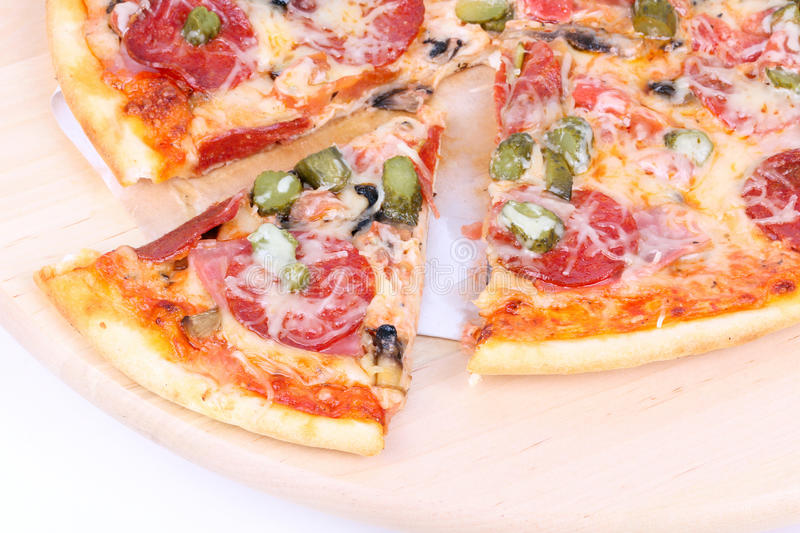 Cutted Pizza On Wooden Board Stock Photos